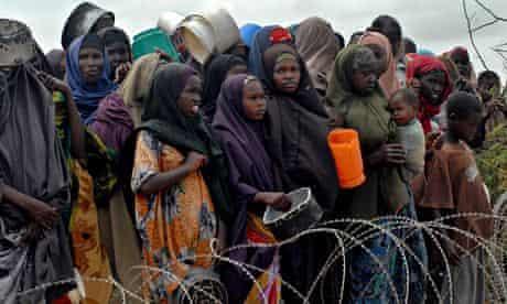 Heat and dust: displaced Somalis wait for food at the Badbaado refugee camp near Mogadishu.