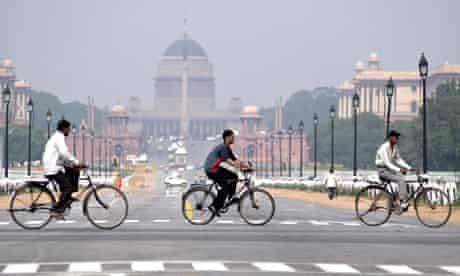 Cyclists pass Lutyens's Rashtrapati Bhavan in New Delhi.