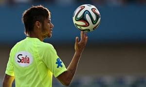 Neymar training in Serra Dourada stadium, in Goiânia, Brazil, earlier this week; below, Pelé celebra