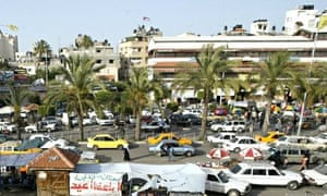 A taxi driver in Talal Abu Shawish's 'Red Lights' dispenses charity while his radio tells of 'siege,