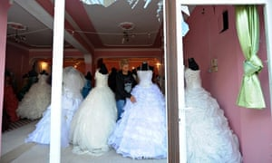 Wedding gowns in a shop window in Reyhanli