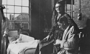 CK Scott Moncrieff (in spectacles) badly wounded in the leg, in Du Cane Road hospital in Hammersmith