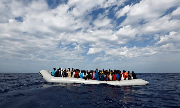 A rubber dinghy with 104 sub-Saharan Africans on board waiting to be rescued