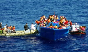 The Italian Navy help refugees in the Mediterranean in 2014.