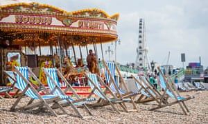 People Cool Off At A Beach In Brighton, England