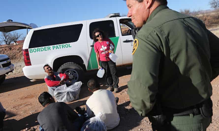 Traces of daily apocalypse … US Border Patrol agents guard Mexican migrants in Arizona.