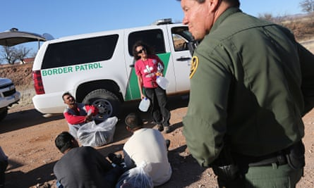 Traces of daily apocalypse … US Border Patrol agents guard Mexican migrants in Arizona.