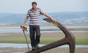 Armitage at Appledore, in north Devon, with the walking stick he cut from a holly bush in his garden