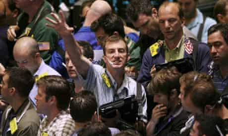 Traders work the crude oil pit at the New York Mercantile Exchange