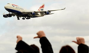 British Airways strikers give the thumbs down to a passing plane
