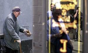 A man begs for outside a Dublin jewellery shop