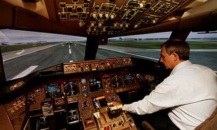 A pilot being trained on a British Airways flight training simulator