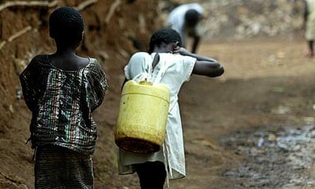 A girl carrying water in Kibera slum, Nairobi.