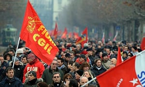 Striking metalworkers march through Turin in a protest over the Monti government's austerity cuts