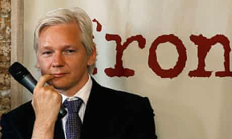 WikiLeaks founder Julian Assange listens during a news conference at the Frontline Club in London