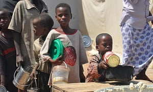 Somali children queue for food in a Mogadishu displaced persons camp