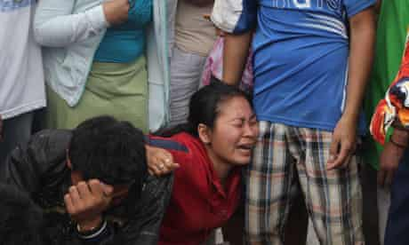 Relatives mourn as they identify bodies