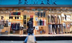 Shoppers walk past a Primark store in London