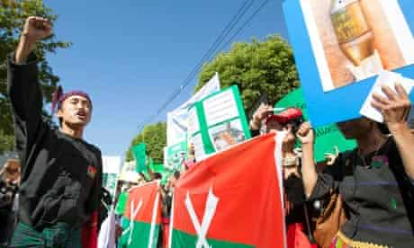 Ethnic Kachin refugees from Myanmar protest against the Burmese military attacks on minority rebels