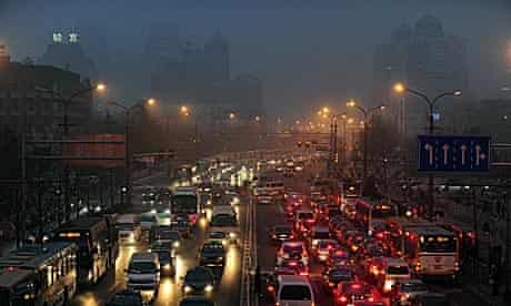 Hazy and polluted day in Beijing brings traffic to a halt