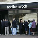 Customers queue outside a branch of Northern Rock. Photograph: Sang Tan/AP