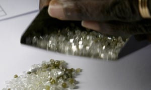 Raw diamonds being checked by a trader