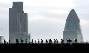 Commuters cross Waterloo Bridge to the City of London