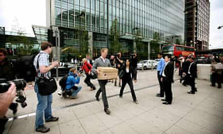 Lehman Brothers employees leaving the Canary Wharf building. Photograph: Graeme Robertson