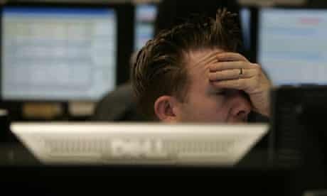 A trader reacts to the falling FTSE 100 at CMC Markets in London. Photograph: Alastair Grant/AP