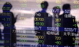 A Nikkei stock indicator board in downtown Tokyo shows the latest slump in Japanese stocks