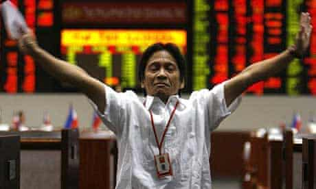 A trader at the Philippines stock exchange as business is halted
