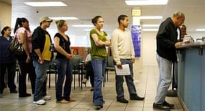People wait at an employment help centre in Miami, Florida as US unemployment hits the worst levels since 1974