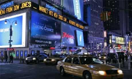 A Times Square billboard displays news of the Dow Jones index fall