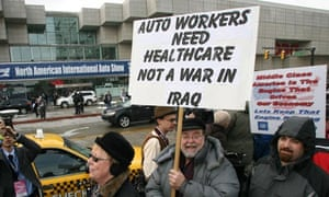 Protesting car workers outside the Detroit motor show