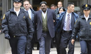 Raj Rajaratnam, billionaire founder of hedge fund Galleon Group, is led in handcuffs by the FBI