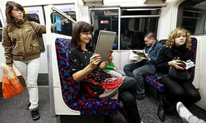woman reads a kindle