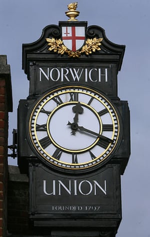 High street brands: The sign and clock outside the Norwich Union bank, Norwich, Norfolk