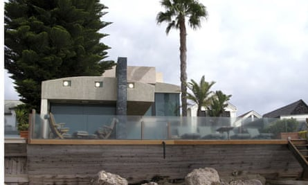 A view of the beachside front of a home at 106 Malibu Colony Road in Malibu