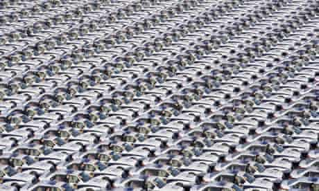 Chinese police officers stand alongside new vehicles during a handover ceremony in Taiyuan