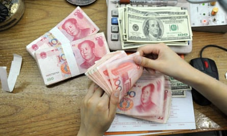 A Chinese bank worker counts 100-yuan no