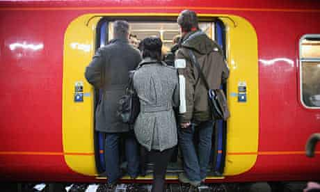 commuters squeeze on to crowded Train at Clapham Junction