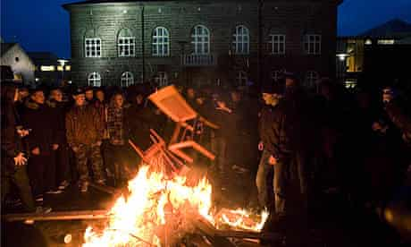 Protesters in Reykjavik burn furniture at a demonstration over the financial crisis