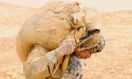 A man works at the site of a rare earth metals mine at Nancheng county