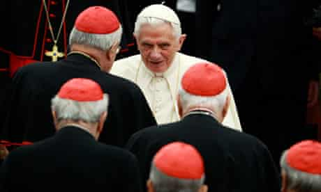 Pope Benedict XVI surrounded by cardinals