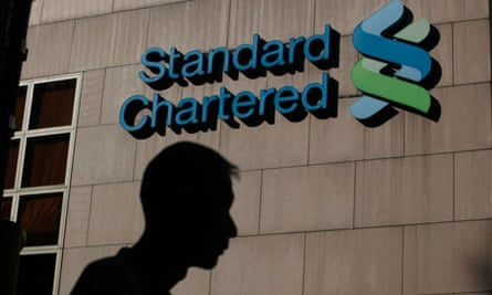 Standard Chartered logo, with shadow of man