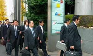 Investigators walk into Olympus offices in Tokyo.