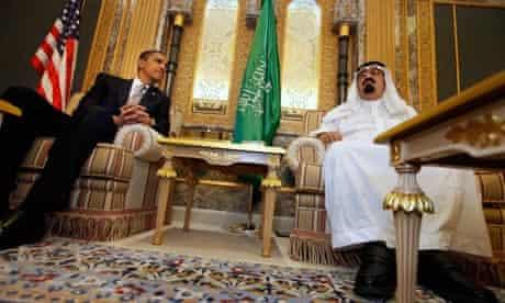 President Barack Obama talks with Saudi King Abdullah in 2009
