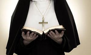 A nun reading a bible