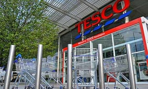 Shopping trolleys in front of a Tesco store in west London