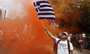A worker in the state telecoms firm OTE protests in Athens at plans to speed up privatisation